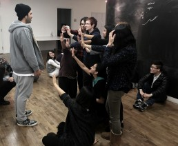 Students role-play a situation of oppression